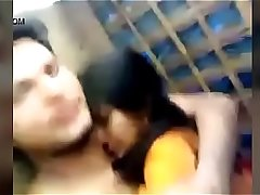 Indian couple outdoor kissing
